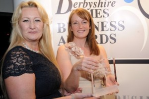 Derbyshire Times Business Awards. Sarah Stevenson of Astute Recruitment, right with her Entrepreneur of the Year award, presented by Melanie Ulyatt.